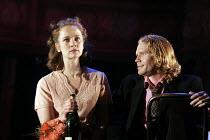 HAMLET by Shakespeare design: Laura Hopkins lighting: Mark Jonathan fights: Terry King director: Rupert Goold <br> Poppy Miller (Ophelia), Michael Shaeffer (Laertes) Royal Theatre, Northampton, Englan...