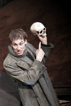 HAMLET by Shakespeare design: Laura Hopkins lighting: Mark Jonathan fights: Terry King director: Rupert Goold <br> Tobias Menzies (Hamlet) with Yorick Royal Theatre, Northampton, England 22/03/2005 (c...