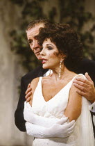PRIVATE LIVES by Noel Coward design: Carl Toms lighting: Leonard Tucker director: Tim Luscombe <br>~Keith Baxter (Elyot Chase), Joan Collins (Amanda Prynne)~Aldwych Theatre, London WC2 19/09/1990~(c)...