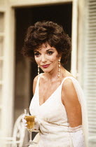 PRIVATE LIVES by Noel Coward design: Carl Toms lighting: Leonard Tucker director: Tim Luscombe <br>~Joan Collins (Amanda Prynne)~Aldwych Theatre, London WC2 19/09/1990~(c) Donald Cooper/Photostage pho...