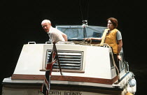 WAY UPSTREAM by Alan Ayckbourn design: Alan Tagg lighting: William Bundy director: Alan Ayckbourn <br> Jim Norton (Alistair), Julie Legrand (Emma) Lyttelton Theatre, National Theatre (NT), London SE1...