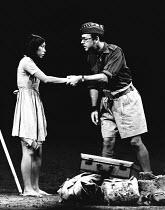 JINGO by Charles Wood set design: John Gunter costumes: Polly Barlow & Charles Wood lighting: Nick Chelton choreographer: Sue Weston director: Richard Eyre <br> Yasuko Nagazumi (Shirley), John Standi...