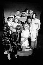 HAMLET by Shakespeare adapted & directed by Charles Marowitz <br> the company, clockwise from front left: Clown, Claudius, Hamlet (in glasses), Guildenstern, Polonius, Rosencrantz, Laertes, Ophelia, F...