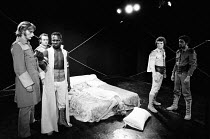 OTHELLO by Shakespeare design: Robin Don adapted & directed by Charles Marowitz <br>front left: Malcolm Storry, Rudolph Walker (Othello) on bed, dead: Judy Geeson (Desdemona) right: David Schofield, A...