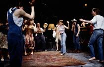 REAL DREAMS by Trevor Griffiths design: Russell Craig lighting: Geraint Pughe director: Ron Daniels <br> dancing, l-r: Michele Costa (Karen), Helena Little (Sally) far right: Adrian Dunbar (Sandler) R...