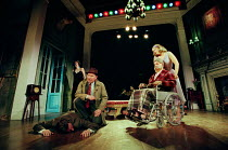 THE REAL INSPECTOR HOUND by Tom Stoppard design: Robert Jones lighting: Howard Harrison director: Gregory Doran <br> left: Anna Chancellor (Cynthia), Geoffrey Freshwater (Inspector Hound) right: Gary...