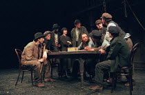THE MACHINE WRECKERS by Ernst Toller in a version by Ashley Dukes design: Vicki Mortimer lighting: Tina MacHugh director: Katie Mitchell <br> seated centre: Ron Cook (John Wibley) Cottesloe Theatre, N...