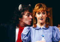 TALK OF THE DEVIL by Mary O'Malley design: Sue Plummer lighting: Michael Calf director: Bill Alexander <br> Ian Dury (The Devil), Kate Lock (Geraldine Maguire) Palace Theatre, Watford, England 03/1986...