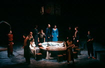 MORTE D'ARTHUR by Sir Thomas Malory dramatised and directed by David Freeman composer: Nigel Osborne design: David Roger lighting: Michael Calf <br> on the table: Chris Tranchell (Merlin / Pelles) wit...