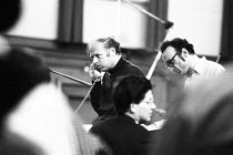 Bernard Haitink (conductor, left ) confers with the production team during a break in recording the Liszt piano concertos with Alfred Brendel (pianist, right) and the London Philharmonic Orchestra (LP...