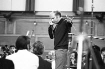 Bernard Haitink (conductor) confers with the production team during a break in recording the Liszt piano concertos with Alfred Brendel (pianist) and the London Philharmonic Orchestra (LPO) in the Asse...