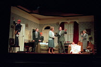 ENJOY by Alan Bennett design: Lez Brotherston lighting: Mark Ridler director: Jeremy Sams <br> council workers prepare to preserve the house - centre: Anne Reid (Connie Craven / Mam) right: James...