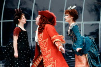 l-r: Janine Duvitski (Nicole), Timothy Spall (Monsieur Jourdain), Anita Dobson (Madame Jourdain) in LE BOURGEOIS GENTILHOMME by Moliere at the Lyttelton Theatre, National Theatre (NT), London SE1 05/0...