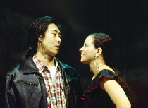 Francois Chau (Greg), Michelle Newell (Mrs Maya) in THE L. A. PLAYS by Han Ong at the Almeida Theatre, London N1 09/11/1993  design: Julian McGowan lighting: Rick Fisher director: Matthew Lloyd