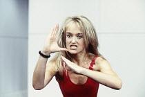 Sophie Heyman (Jane) in PUNCHBAG by Robert Llewellyn at the Hampstead Theatre, London NW3 07/12/1993  design: Julian McGowan lighting: Alan Burrett fights: William Hobbs choreography: Danny John-J...