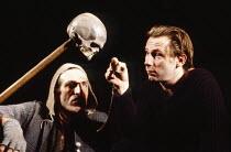 l-r: Richard Strange (Gravedigger), Daniel Webb (Hamlet) in HAMLET by Shakespeare at the Haymarket Theatre Leicester, England 19/09/1989 international touring production design: David Borowsky lig...