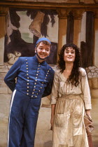 Tony Haygarth (Buttons), Janet Didbley (Cinderella) in CINDERELLA at at the Lyttelton Theatre, National Theatre (NT) London 15/12/1983  set design: William Dudley costumes: Deirdre Clancy lighting...