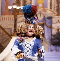 Derek Newark (Gloria) in CINDERELLA at at the Lyttelton Theatre, National Theatre (NT) London 15/12/1983  set design: William Dudley costumes: Deirdre Clancy lighting: William Bundy choreography:...