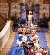 l-r: Derek Newark (Gloria), Robert Stephens (Euphoria) in CINDERELLA at at the Lyttelton Theatre, National Theatre (NT) London 15/12/1983  set design: William Dudley costumes: Deirdre Clancy light...