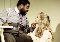 Clive Rowe (Enoch Snow), Janie Dee (Carrie Pipperidge) in CAROUSEL by Rodgers & Hammerstein at the Lyttelton Theatre, National Theatre (NT), London SE1 12/1992  music: Richard Rodgers book & lyric...
