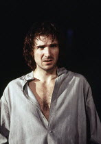 Ralph Fiennes (Hamlet) in HAMLET by Shakespeare at the Hackney Empire, London E8 28/02/1995  an Almeida Theatre production set design: Peter J Davidson costumes: James Acheson lighting: Mark Hende...