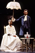 Susan Harper-Browne (Mamila), Sean Baker (Giles Pearson) in INDIGO by Heidi Thomas at the Thomas Royal Shakespeare Company (RSC), The Other Place, Stratford-upon-Avon 08/07/1987  design: Roger Glo...