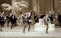 front centre, l-r: Donald Adams (Pooh-Bah), Susan Bullock (Yum-Yum), Eric Shilling (Pish-Tush) in THE MIKADO by Gilbert & Sullivan at English National Opera (ENO), London Coliseum, London WC2 23/11/19...