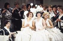 l-r: Lesley Garrett (Yum-Yum), Elizabeth McCormack (Pitti-Sing), Helen Kucharek (Peep-Bo) in THE MIKADO by Gilbert & Sullivan at English National Opera (ENO), London Coliseum, London WC2 21/02/1990&#x...