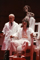 undergoing aversion therapy - l-r: Russell Enoch (Dr Brodsky), Phil Daniels (Alex) in A CLOCKWORK ORANGE 2004 at the Royalty Theatre, London WC2 26/05/1990  a Royal Shakespeare Company production...