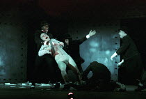 the Droogs - l-r: Christopher McHallem (Pete), Phil Daniels (Alex), Robbie Gee (George), Patrick Brennan (Dim) - attack and strip a victime in A CLOCKWORK ORANGE 2004 at the Royalty Theatre, London WC...