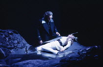 placing a shield on his sleeping daughter: Anthony Raffell (Wotan), Linda Esther Gray (Brunnhilde) in THE VALKYRIE by Wagner at English National Opera (ENO), London Coliseum 22/10/1983 conductor:...