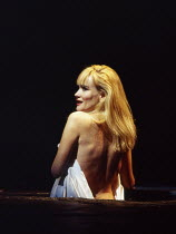Sian Rivers (Mae Rose Cottage) in UNDER MILK WOOD by Dylan Thomas at the Olivier Theatre, National Theatre (NT), London SE1 13/04/1995 music: Dominic Muldowney design: William Dudley lighting: Rick Fi...