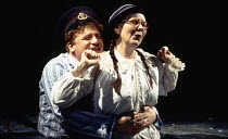 Mark Lewis Jones (Willy Nilly), Shirley King (Mrs Willy Nilly) in UNDER MILK WOOD by Dylan Thomas at the Olivier Theatre, National Theatre (NT), London SE1 13/04/1995 music: Dominic Muldowney design:...