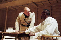 l-r: Simon Russell Beale (Iago), David Harewood (Othello) in OTHELLO by Shakespeare at the Cottesloe Theatre, National Theatre (NT), London 16/09/1997 design: Anthony Ward lighting: Paul Pyant fights:...
