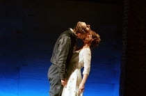 at the ball, the first kiss: David Tennant (Romeo), Alexandra Gilbreath (Juliet) in ROMEO AND JULIET by Shakespeare at the Royal Shakespeare Company (RSC), Royal Shakespeare Theatre, Stratford-upon-Av...