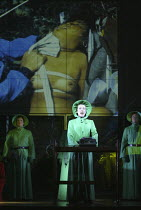 Helen Field (Aunt Lydia) with a projected 'pornographic' image in THE HANDMAID'S TALE at English National Opera (ENO), London Coliseum, London WC2 03/04/2003 music: Poul Ruders libretto: Paul Bentley...