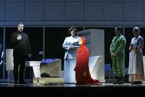 l-r: Stephen Richardson (The Commander), Catherine Wyn-Rogers (Serena Joy), Stephanie Marshall (Offred), Richard Coxon (Nick), Ethna Robinson (Rita) in THE HANDMAID'S TALE at English National Opera (E...