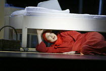hiding: Stephanie Marshall (Offred) in THE HANDMAID'S TALE at English National Opera (ENO), London Coliseum, London WC2 03/04/2003 music: Poul Ruders libretto: Paul Bentley after the novel by Margaret...