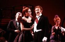 Lesley Garrett (Valencienne), Eric Shilling (Baron Zeta) in THE MERRY WIDOW by Franz Lehar at the English National Opera (ENO), London Coliseum, London WC2 26/03/1986 lyrics: Victor Leon & Leo Stein c...