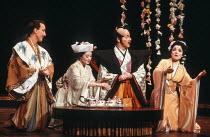 Tea Service - l-r: John Keane (Nanki-Poo), Marie Baron (Yum-Yum), Paul Massel (Pish-Tush), Karen Wood (Pitti-Sing) in THE MIKADO by Gilbert & Sullivan at The Old Vic, London SE1 29/02/1984 a Stratford...