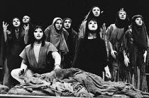 'Choephori' - front centre: Orestes and Electra with Chorus of Trojan Women in THE ORESTEIA by Aeschylus at the Olivier Theatre, National Theatre (NT), London SE1 28/11/1981 in a version by Tony Harri...