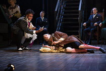 'The Murder of Gonzago' - Ashley G Gayle (Player) poisons Nick Howard-Brown (Player King), watched by Frances Barber (Polonius) and Jonathan Hyde (Claudius) in HAMLET by Shakespeare opening at the The...