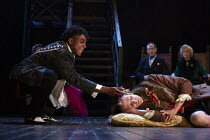 'The Murder of Gonzago' - Ashley G Gayle (Player) poisons Nick Howard-Brown (Player King), watched by Jonathan Hyde (Claudius), Jenny Seagrove (Gertrude) in HAMLET by Shakespeare opening at the Theatr...