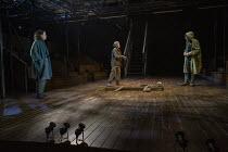 Graveyard scene - l-r: Ben Allen (Horatio), Llinos Daniel (Gravedigger), Ian McKellen (Hamlet) in HAMLET by Shakespeare opening at the Theatre Royal Windsor, England on 20/07/2021 set design: Lee Newb...