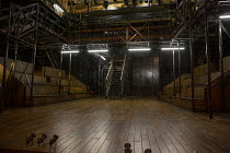 full stage set for HAMLET by Shakespeare opening at the Theatre Royal Windsor, England on 20/07/2021, showing the floor, stairs, on-stage seating, elevated platforms and lighting gantry set design: Le...