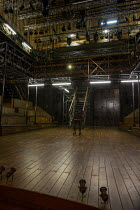 the set for HAMLET by Shakespeare opening at the Theatre Royal Windsor, England on 20/07/2021, showing the stage floor, stairs, on-stage seating, elevated platforms and lighting gantry, rig and lights...