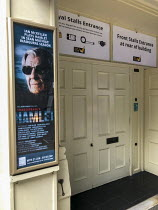 Royal Stalls entrance to the Theatre Royal Windsor, England displaying a poster for HAMLET by Shakespeare starring Sir Ian McKellen as the Danish Prince, running from June to September 2021. Directed...