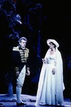 final scene, in the garden at night: Thomas Allen (Count Almaviva), Felicity Lott (Countess Almaviva) in LE NOZZE DI FIGARO at The Royal Opera, Covent Garden, London WC2 18/12/1991 music: Wolfgang Ama...