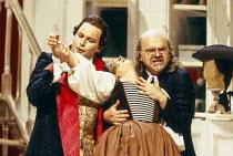 l-r: Andreas Schmidt (Count Almaviva), Alison Hagley (Susanna), Robert Tear (Don Basilio) in LE NOZZE DI FIGARO at Glyndebourne Festival Opera, East Sussex, England 28/05/1994 music: Wolfgang Amadeus...