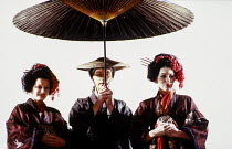 flower girls in MADAM BUTTERFLY by Puccini at English National Opera (ENO), London Coliseum, London WC2 1988 music: Giacomo Puccini libretto: Luigi Illica and Giuseppe Giacosa conductor: Lionel Friend...